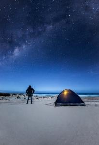 Man looking up towards the Milky Way. Eyre Peninsula. South Australia.