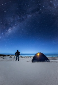 Man looking up towards the Milky Way. Eyre Peninsula. South Australia.